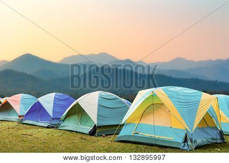 group of tourist tent on the hills