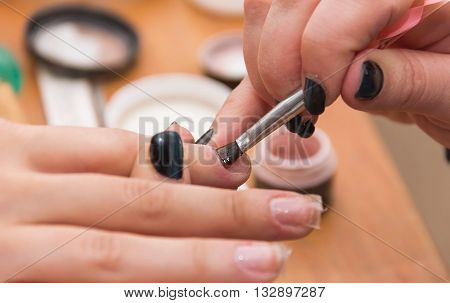 build artificial nails manicures artificial nails correction the industry of beauty and nail care beauty salons a process of increasing in the hands nail esthetics soft focus