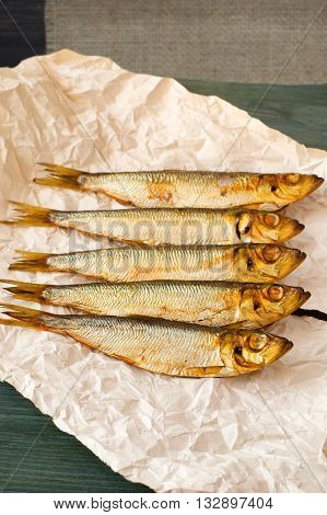 herring sprat fish smoked on a wooden table