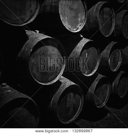 A damp dark cellar is the perfect place for barrels of vintage port wine to be stored while the wine ages.