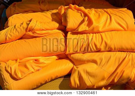 yellow robe of Buddhist monk pattern background