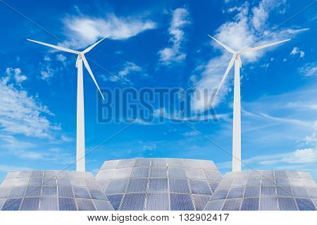 Solar panels and wind turbine against blue sky backgrounduseful for carbon credits concept.
