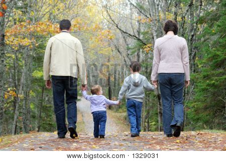 a family walking together through the woods in october poster