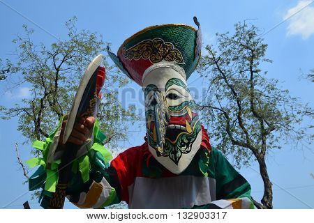 Phi Ta Khon is a type of masked procession celebrated on the first day of a three-day Buddhist merit-making holiday known in Thai as