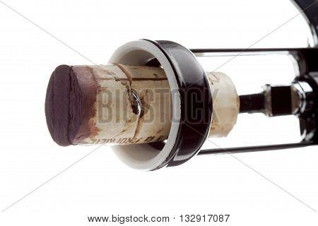 close up shot of cork screw on white background