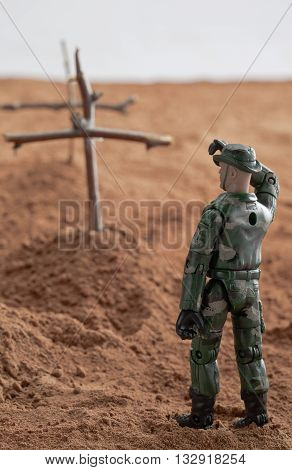 Toy Soldier Giving A Salute To His Dead Co Soldier