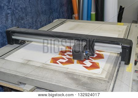 flatbed cutting plotter in a working process