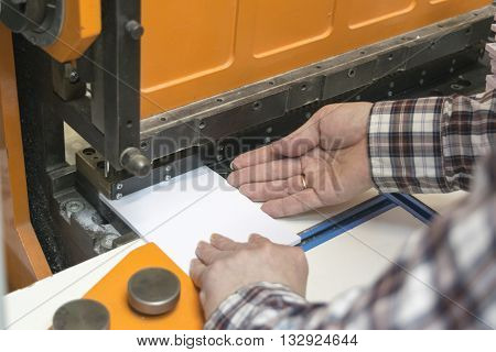 operator of guillotine machine are cutting papers