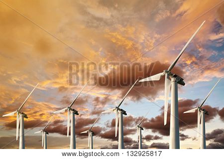 Wind Energy Blows Into Future Amarillo And Turbine Farms On Blue Sunset In Twilight Background