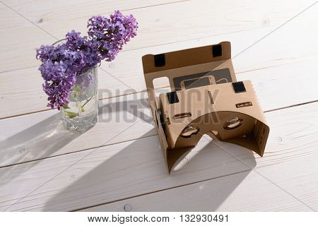 Lilac Bouquet And Cardboard Vr Glasses On The Table