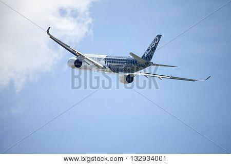 BERLIN / GERMANY - JUNE 32016: Airbus A 350 - 900 plane flight on airport in Berlin / Germany on June 3 2016.