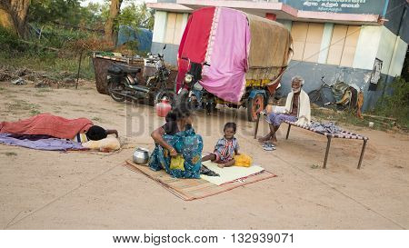 Pondicherry country, India - June 15 2014. Gipsy camp early in the morning. Just get up, working, family closed together, poor workers without house, family way of life