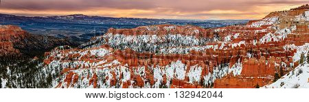 A Rare View Of The Bryce Canyon National Park Natural Amphitheaters In The Snow During Winter Sunris