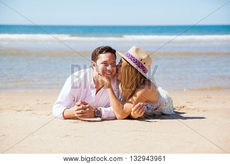 Young Man And His Wife Relaxing At The Beach