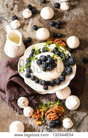 Meringue Pavlova Cake With Fresh Blueberries And Walnuts On Dark