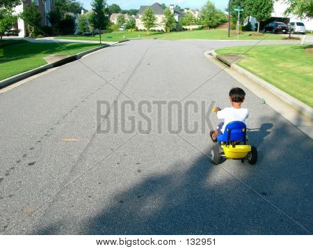 Boy Riding Tricle