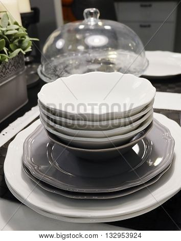 Kitchen Utensil Set of White Ceramic Dishes Bowls and Plates Preparing for Serve Hot and Cold Food.