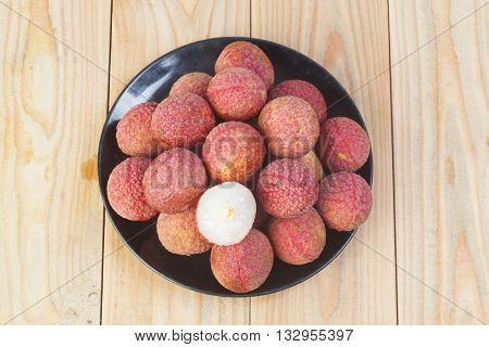 fresh lychees on wooden suitable for background