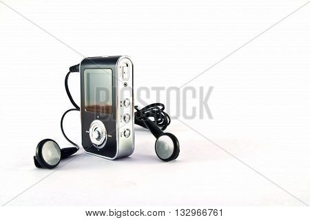 mp3 player and headphones isolated on white background