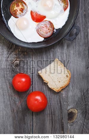 Omelette With Tomato In Frypan On Rustic Gray Wooden Background