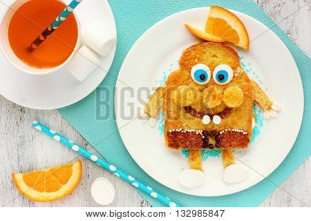 Fun and healthy breakfast for kid egg toast with chocolate orange marshmallow in the form of cute personage