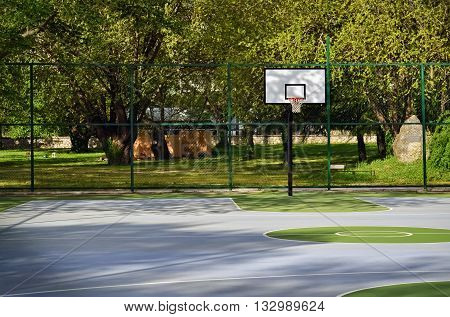 Unoccupied basketball playground in the city park
