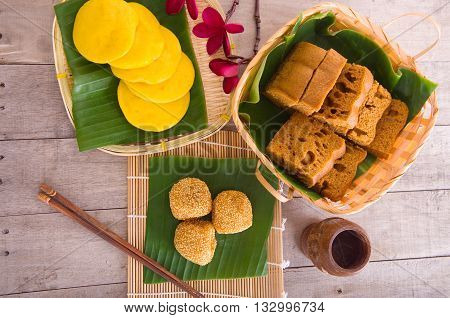 Ma Lai Gou-Traditional malaysia steamed cake.Malaysia desert Onde-Onde or known as Chinese Sesame Ball on banana leaf. Steam chinese cake on bamboo plate.