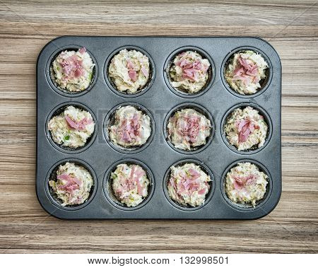 Delicious muffins stuffed with ham and cheese on the tray. Food preparation. International cuisine. Festive food. Tasty muffins. Food theme.