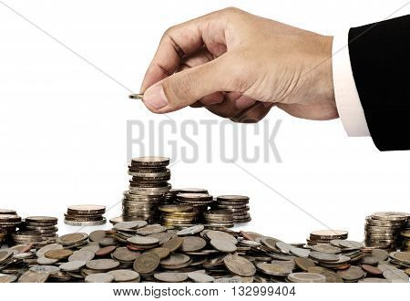 Businessman hand putting money coins, saving money concept, isolated on white background