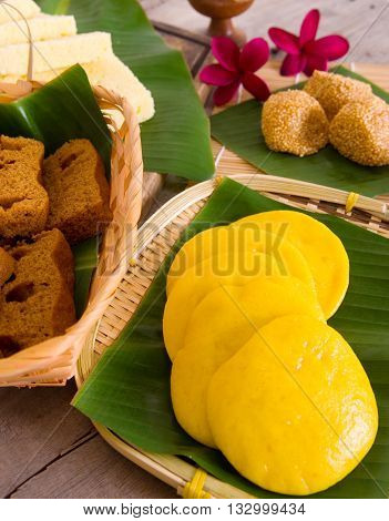Ma Lai Gou-Traditional malaysia steamed cake.Malaysia desert Onde-Onde or known as Chinese Sesame Ball on banana leaf. Steam chinese cake on bamboo plate. Chinese egg cake on banana leaf.