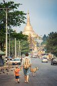 Tourists are going to Shwedagon pagoda in Yangon. Myanmar poster