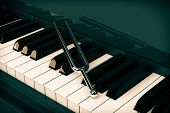 Tuning Fork on top of Piano Keys extreme Closeup. 3d Rendering poster
