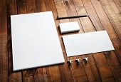 Blank stationery and corporate identity set on vintage wooden table background: letterhead business cards envelope and pencil. Blank mock-up for design portfolios. poster
