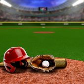 Baseball stadium full of fans in the stands with baseball helmet bat glove and ball on infield dirt clay. Deliberate focus on equipment and foreground with shallow depth of field on background. Floodlights flare for effect and copy space. poster