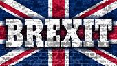 United Kingdom exit from europe relative image. Brexit named politic process. Referendum theme. Brexit text on Britain national flag backdrop textured by brick wall poster