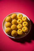 indian sweets bundi laddu or motichur laddu and kesar pedha or pera poster