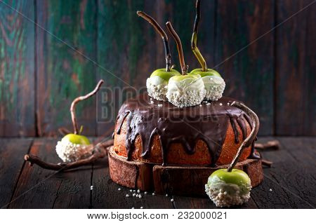 Cake With Chocolate Icing And Green Apples