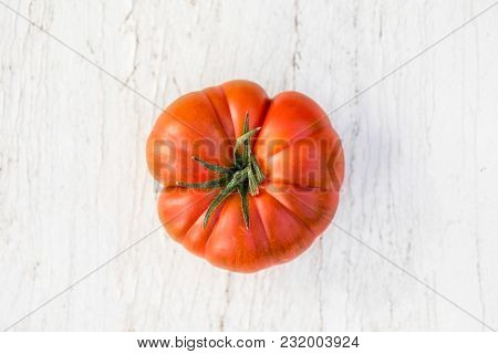 One  Big Tomato  On  Old Wooden Table, Copyspace. Huge Beefsteak Tomato Kind For Cooking. Food Organ