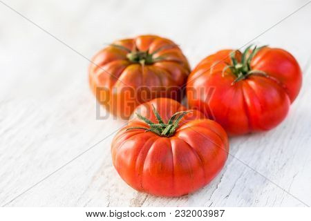 Tomatoes On Bright Wooden Background With Copy Space. Fresh Ripe Organic Tomatoes On Rustic White Wo