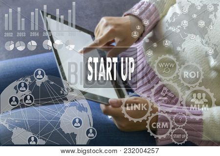 Start Up On The Touch Screen With A Blur The Girl With The Gadget Background .the Concept Of Start U