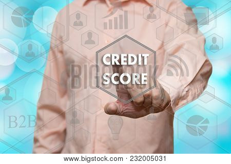 An Elderly Businessman Chooses Credit Score Button On The Touch Screen With A Blur Futuristic Backgr