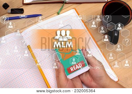Multi-level Marketing. Mlm On The Touch Screen To The Network, On Office Blur Background.concept Of
