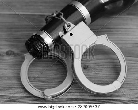 Bottle Beer And Handcuffs, The Concept Of Sobriety And Drunkenness