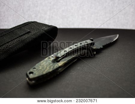 Hunting Knife With Case On Dark Background