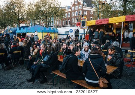 Amsterdam, Netherlands - April 25, 2017:people In Outdoor Cafe On Crowded Nieuwmarkt New Market Squa