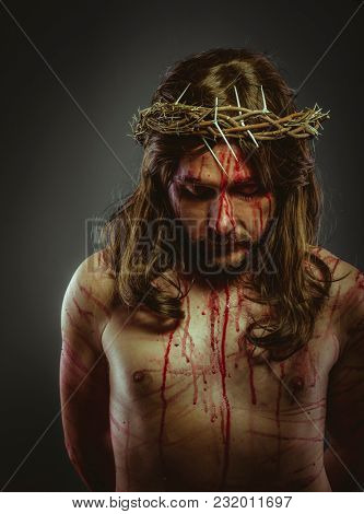 Crucifixion, representation of the Calvary of Jesus Christ on the cross. Holy Week in Spain. man with crown of thorns