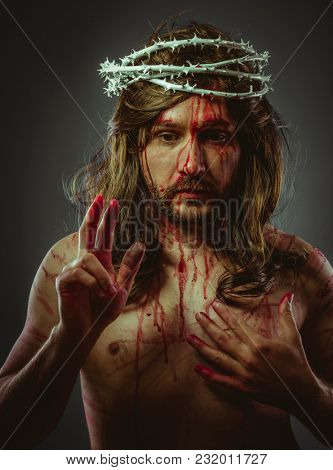 Faith, representation of the Calvary of Jesus Christ on the cross. Holy Week in Spain. man with crown of thorns