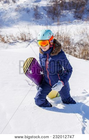 Photo Of Female Athlete Wearing Helmet With Snowboard Going In Winter Park