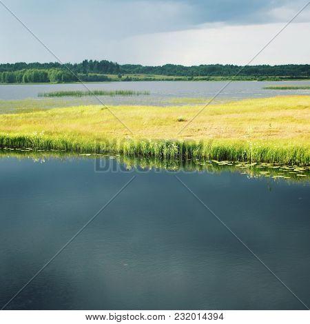Kenozero Lake Before The Rain. Aged Image. Summer Day. Russian North. Water Plants And Grasses. Copy