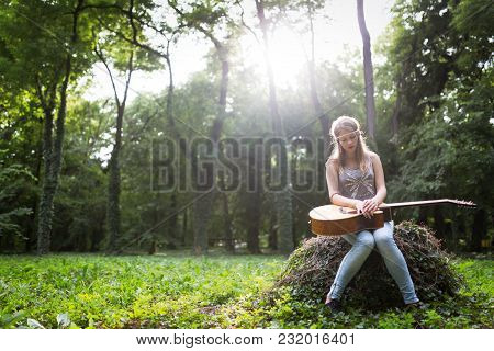 Heartbroken Woman In Nature With Guitar Battles Depression